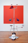 Alex Da Corte, <em>Soft Alert Palimpsest (Six Characters in Search of an Author)</em>, 2013. Millinery display stand, steel, hair scrunchie, flashlight, embroidered baseball caps, latex paint, Catwoman cardboard cutout, colour Xerox, thumb tacks, adhesive mirror vinyl